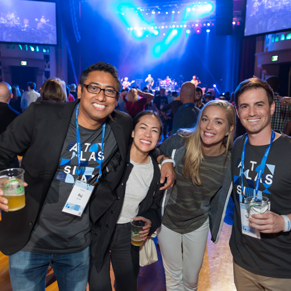 Atlassians at Summit with food and drinks