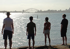 Atlassians looking out at Sydney Harbour
