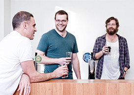 Employees having an after-work beer at Atlassian Sydney
