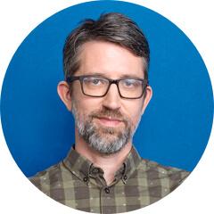 Cancer Research UK の Greg 氏の顔写真