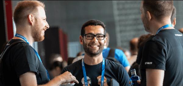 Three Atlassians smiling